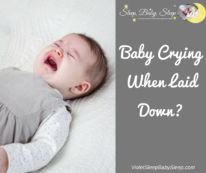 baby crying when laid down